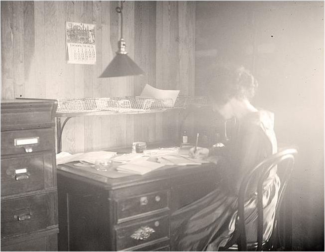 Early Twentieth-Century author at her desk